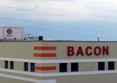 Bacon sign on building front wall
