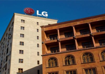 LG brand sign in top of building