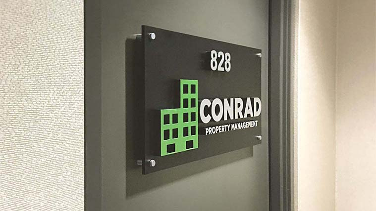 Acrylic Sign with stand-offs for Conrad property management