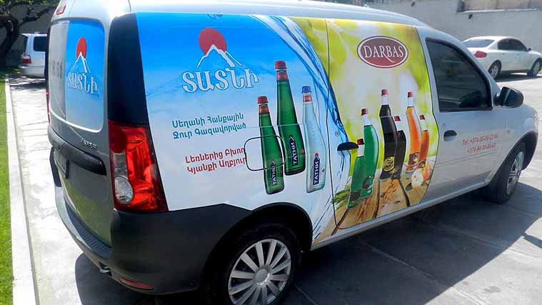 Custom Vehicle Wrapping on a beverage making company's car