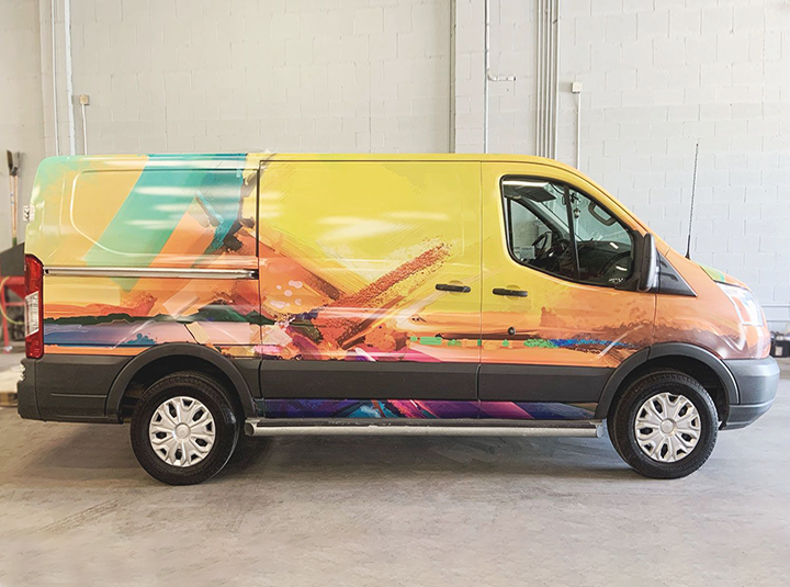 full vehicle branding with large colorful graphics made of opaque vinyl