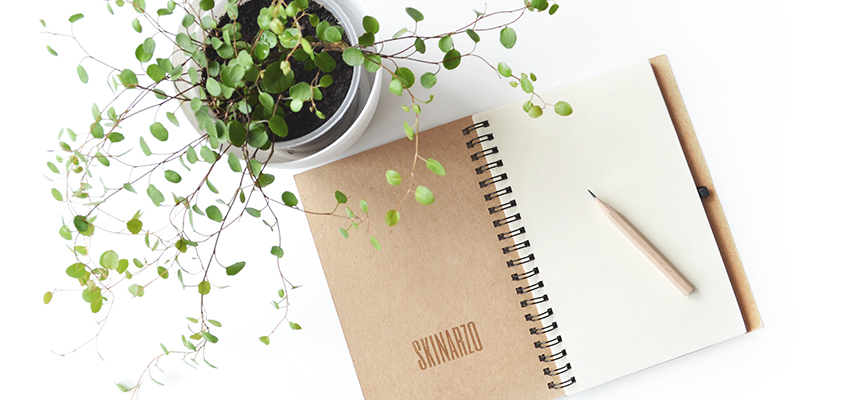 Eco-friendly notepad displaying the brand name