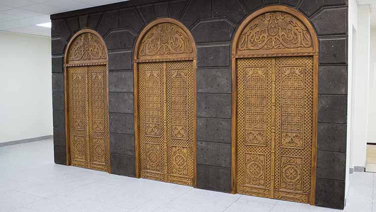 Engraved wooden doors