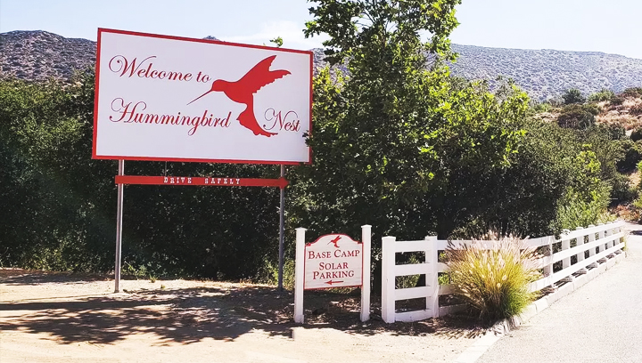 Hummingbird Nest pylon sign without illumination with a welcoming message made of Dibond