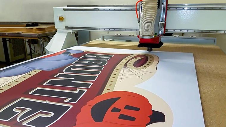 Cutting a custom halloween themed PVC Sign with a CNC Miller