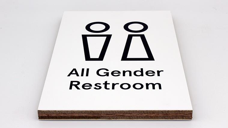 Plywood restroom sign