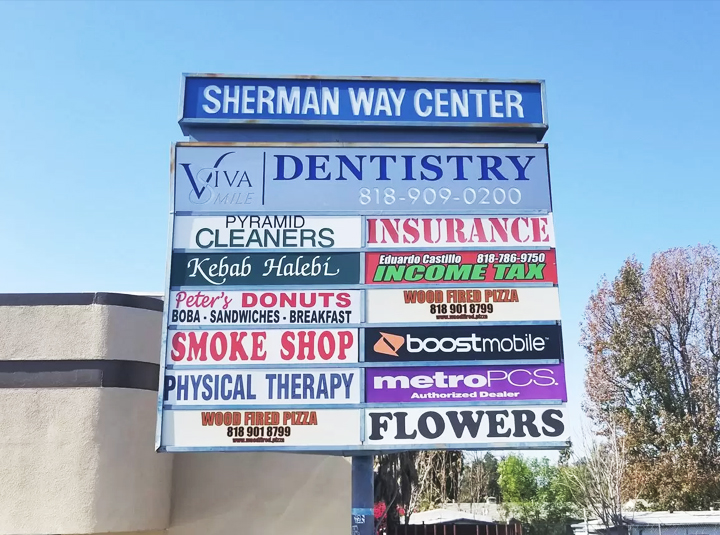 outdoor pylon sign design with multiple brand names made of Lexan and opaque vinyl