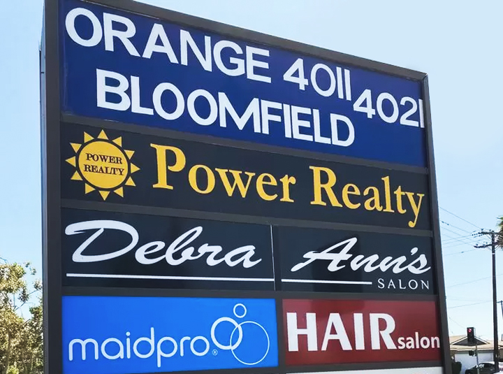 outdoor pylon sign in an elegant style with multiple brand names made of aluminum and acrylic