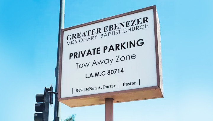 single-poled plaza sign with directional information made of aluminum and acrylic
