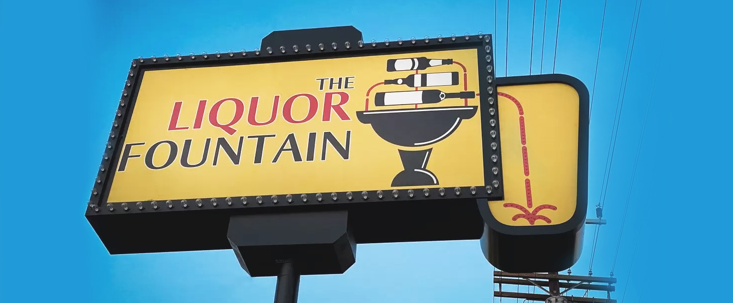 The Liquor Fountain plaza signage custom-made of aluminum and acrylic for brand visibility