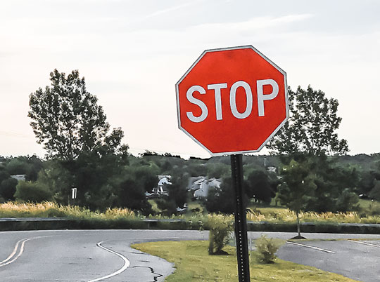 Street stop sign with pole