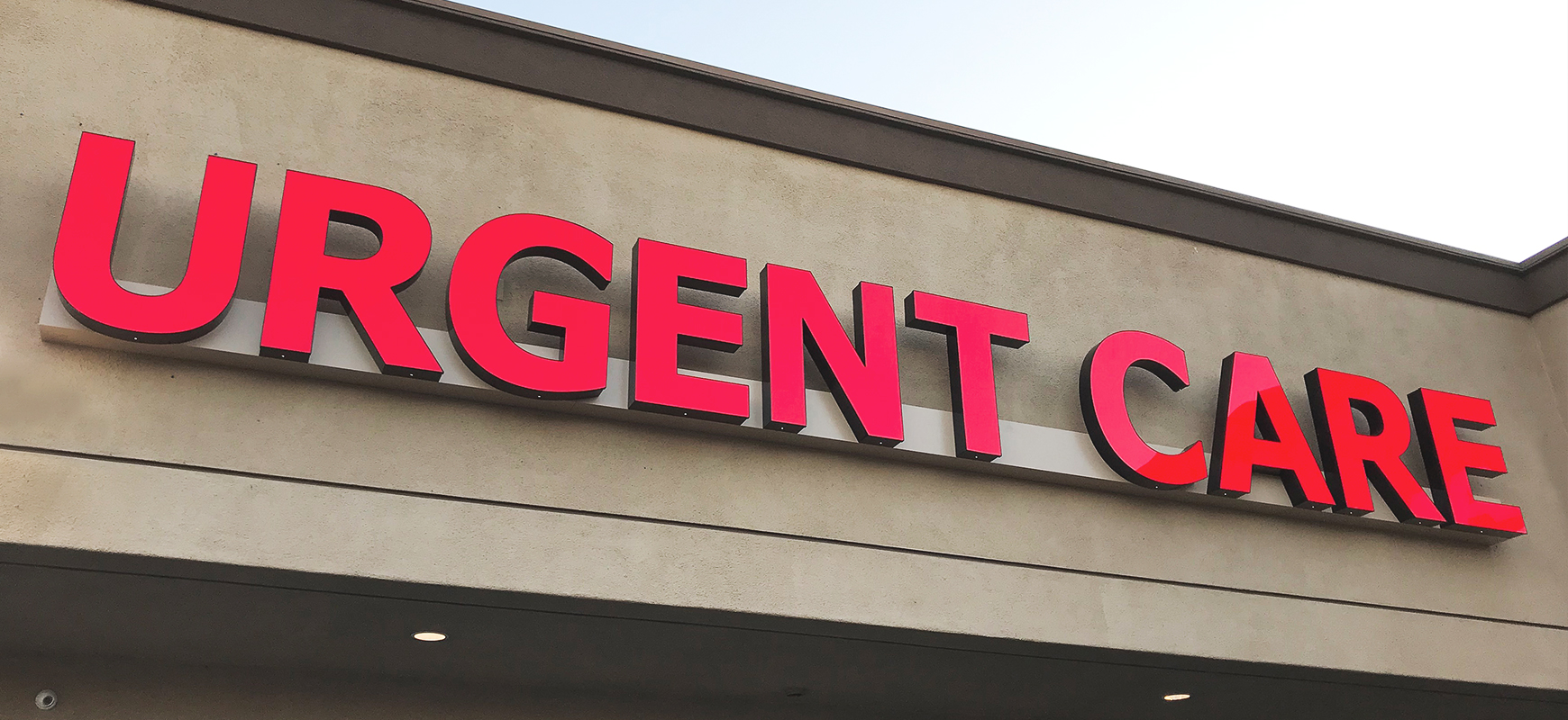Urgent Care channel letter sign in red color displaying the company name made of aluminum and acrylic for business visibility