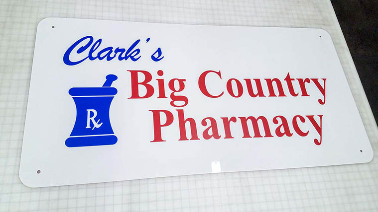 Aluminum Sign with Vinyl Letterings for Clark's Big Country Pharmacy