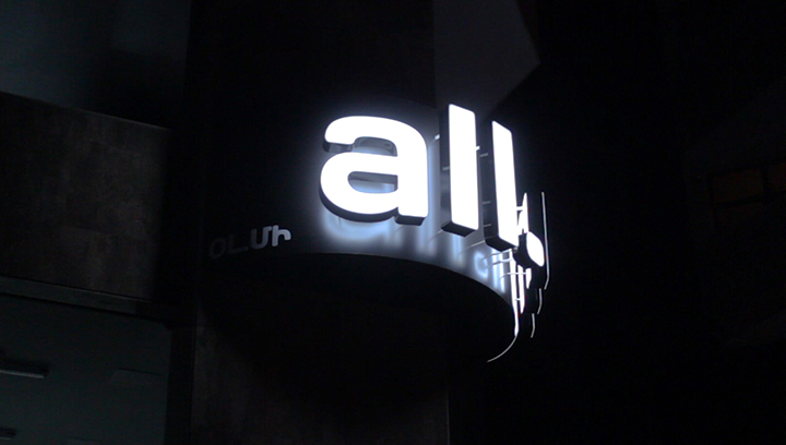 All.me dual lit channel letters displaying the company name made of aluminum and acrylic for business night-time visibility