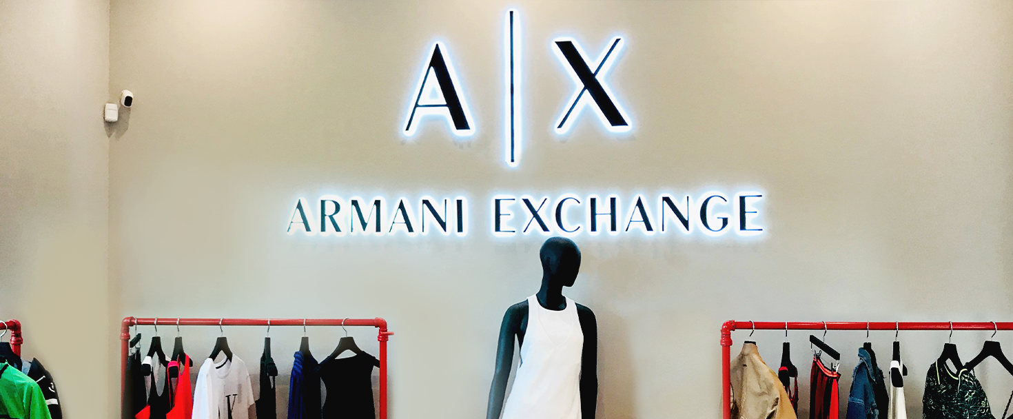 Armani Exchange backlit interior signage with the name and logo of the company made of aluminum and acrylic for branding