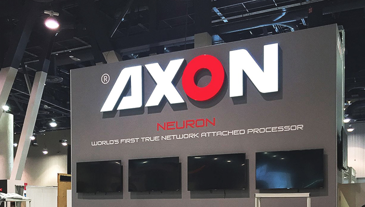 Axon retail channel letters in white and red displaying the company name made of aluminum and acrylic for store branding