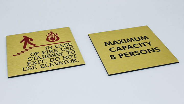 building safety signs displaying warning messages made of brushed aluminum for keeping safety at the business interior space