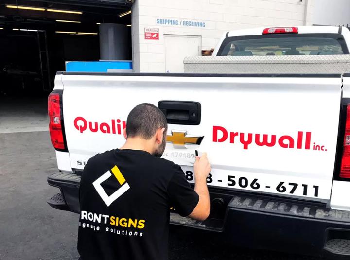 Quality Drywall inc. car graphics installation process