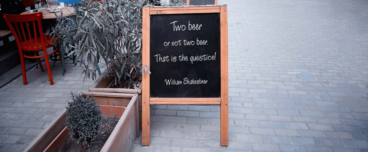 creative beer quote chalkboard a-frame on pavement