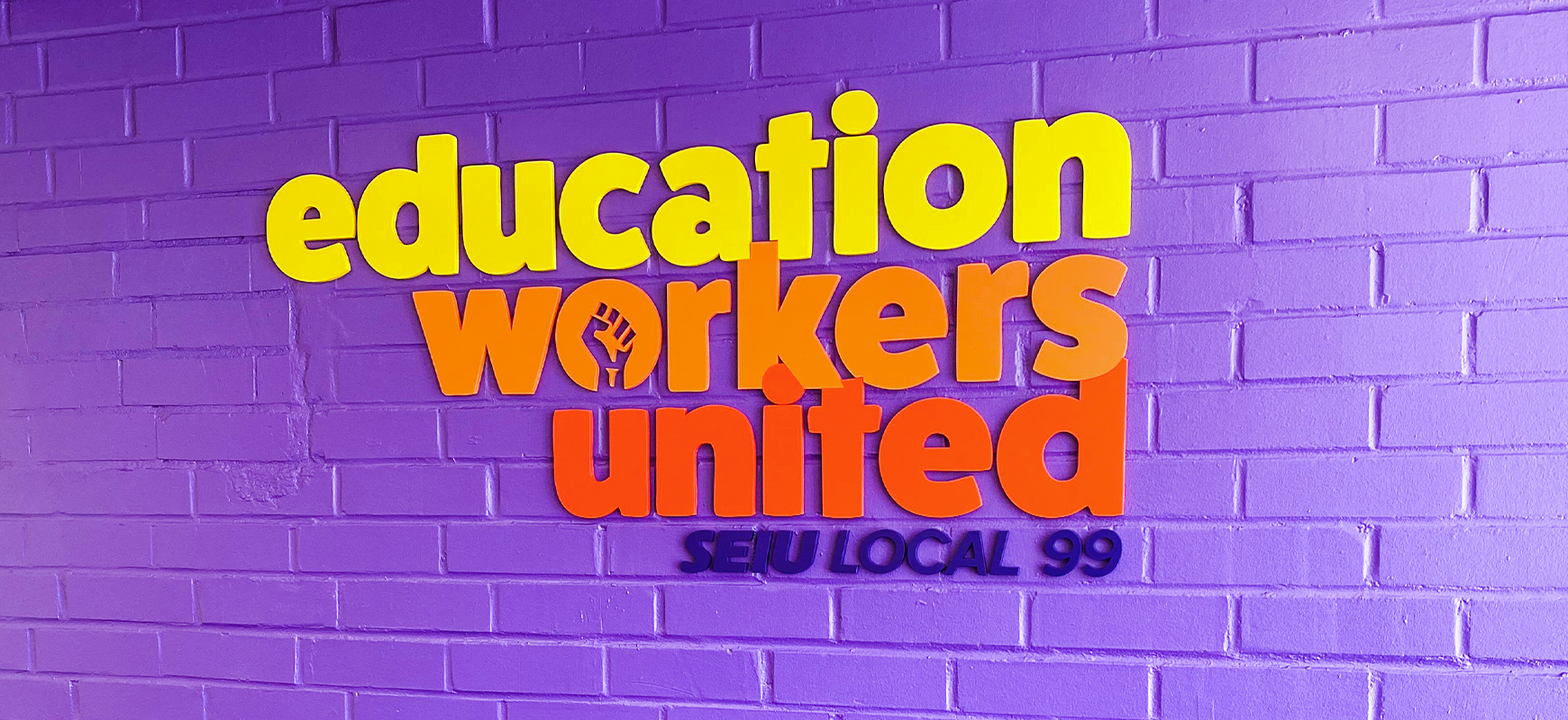 Education Workers United custom interior sign with painted colorful 3D sign letters made of acrylic for branding indoors