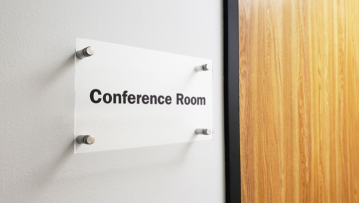 Conference room interior nameplate sign displaying the room's name made of acrylic for wayfinding