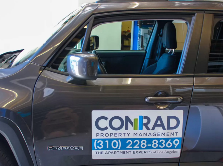 Conrad reusable car magnet displaying the brand name and contact details
