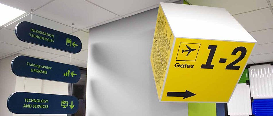 Yellow colored directional lobby sign - Front Signs
