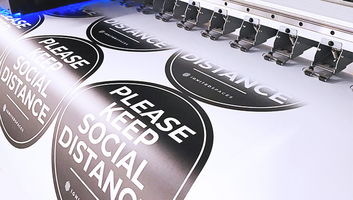 custom indoor social distancing signs in black and white made of opaque vinyl for ensuring safety at the business venue