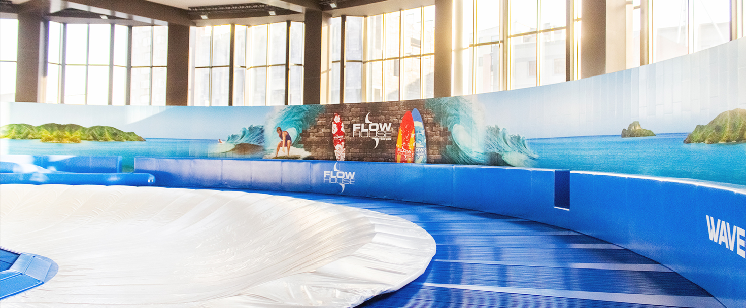 Flow House indoor wall signs displaying custom decorative graphics made of opaque vinyl for surf arena interior branding