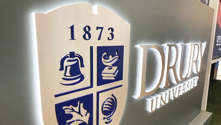 Drury University edge lit channel letters with it's name and logo made of brushed aluminum and acrylic for outdoor visibility