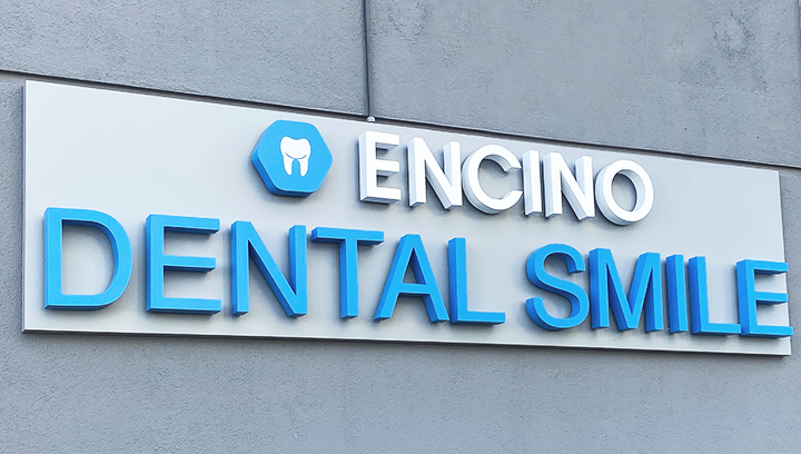 Encino Dental Smile channel letter sign fixed with wireway mounting made of aluminum and acrylic for brand outdoor visibility