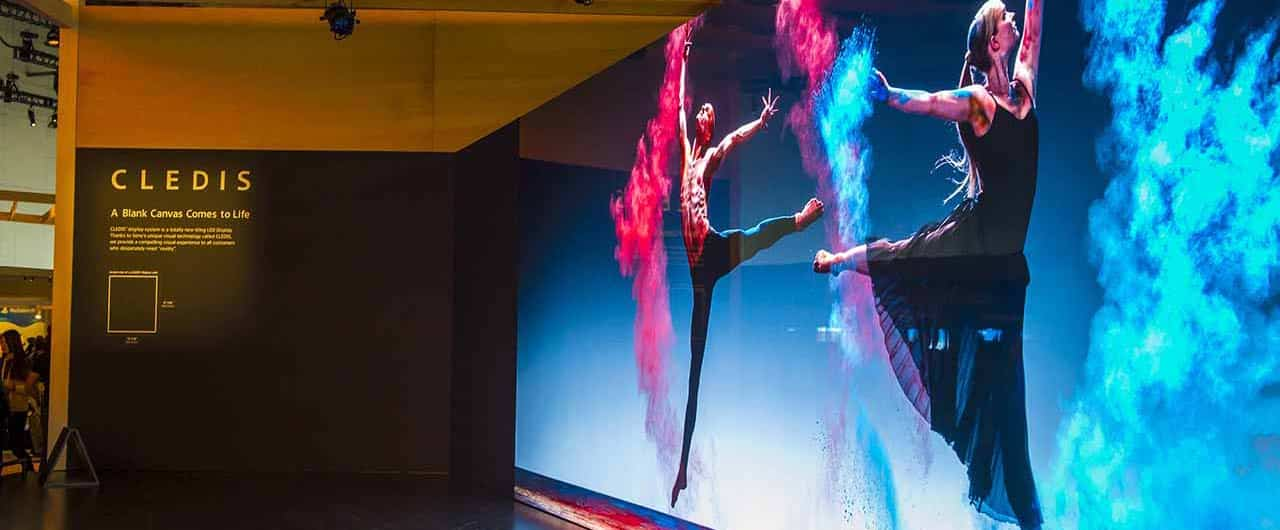 CLEDIS colorful trade show display with dancers printings