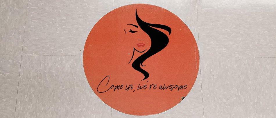 Welcome floor graphic in beauty salon