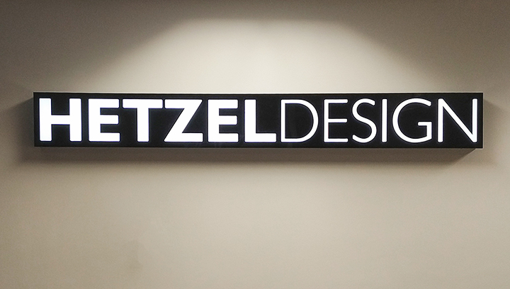 Hetzel Design office light box sign displaying the company name made of aluminum and acrylic