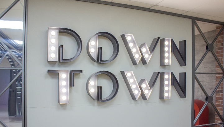 Ameriabank open face channel letters displaying the words Down Town made of aluminum and acrylic for interior design