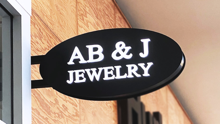 Ab & J Jewelry shopping center light box sign in an oval shape made of aluminum and acrylic