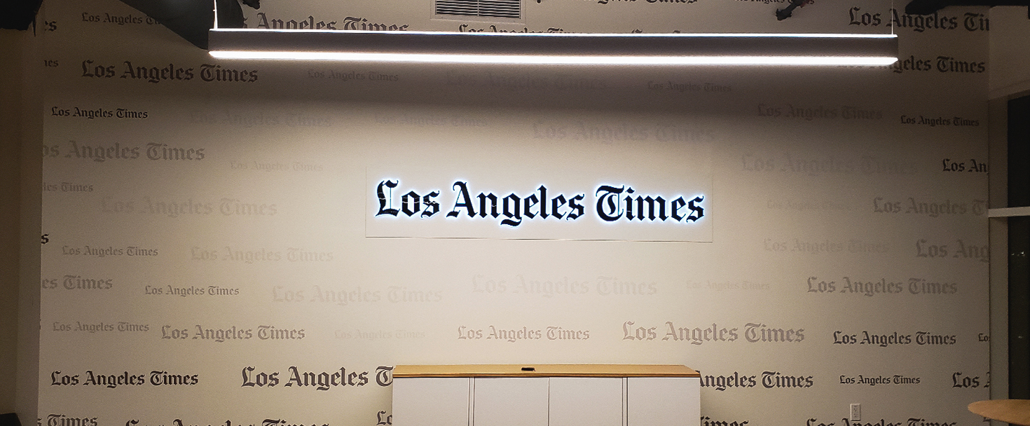 LA Times backlit interior signage displaying the company name custom-made of opaque vinyl, acrylic and aluminum for branding