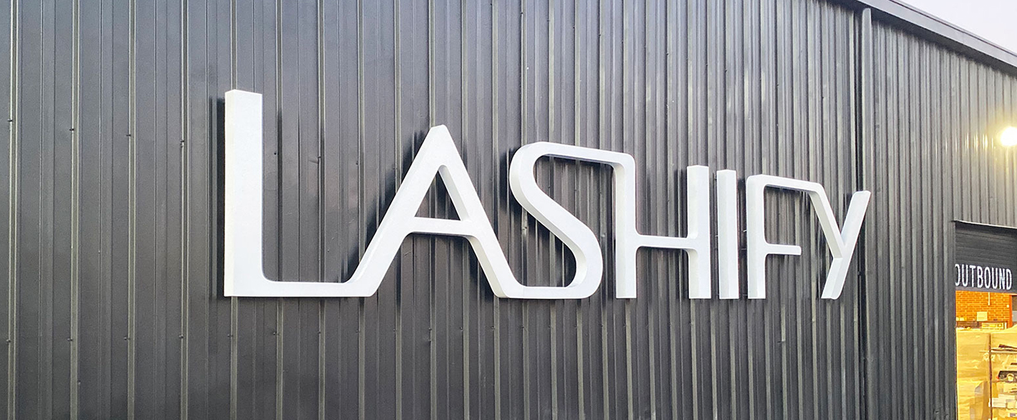 Lashify channel letters in white color displaying the company name made of aluminum and acrylic for brand outdoor visibility