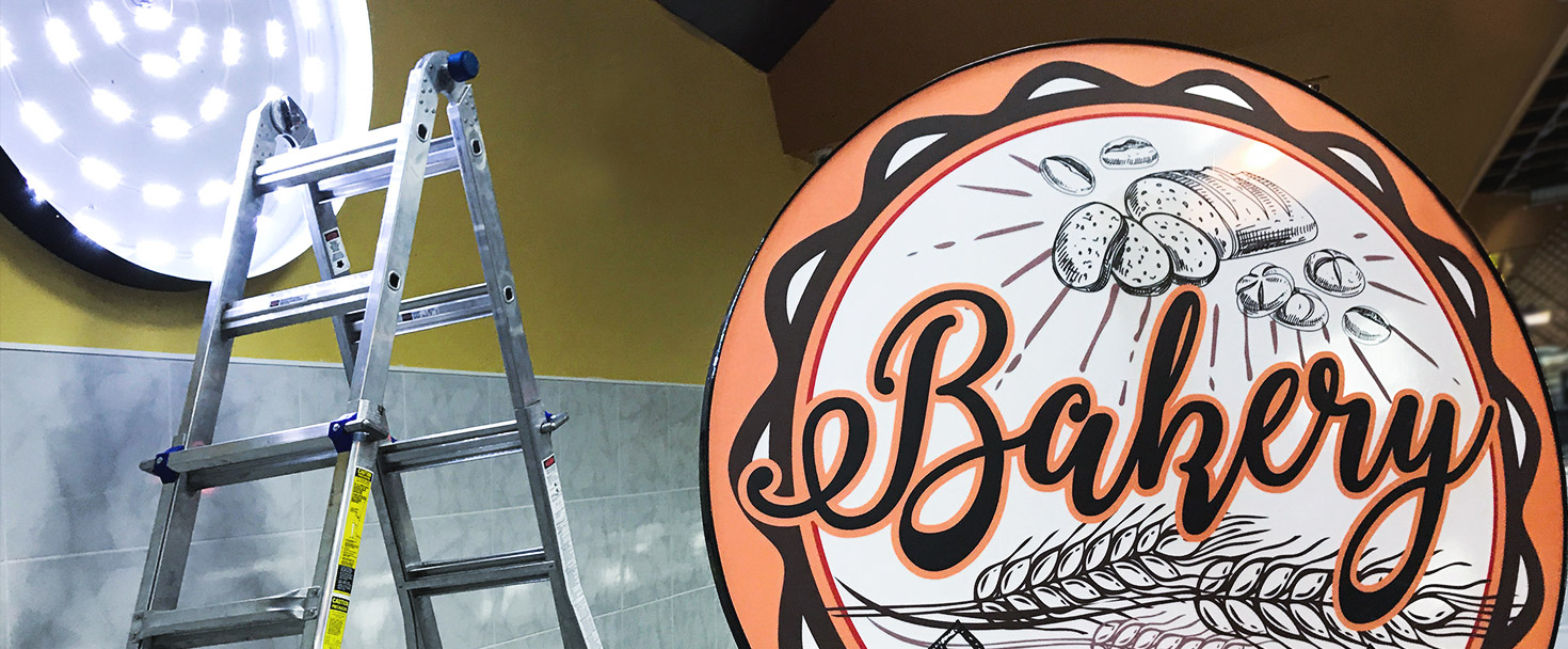 Bakery light box sign in a round shape made of acrylic, aluminum, and backlit vinyl