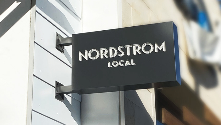 Nordstrom Local wall blade light box sign in black color made of aluminum and acrylic