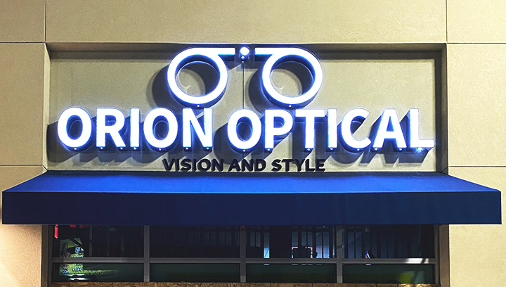 Orion Optical face lit channel letters with the company name and logo made of aluminum and acrylic for business visibility