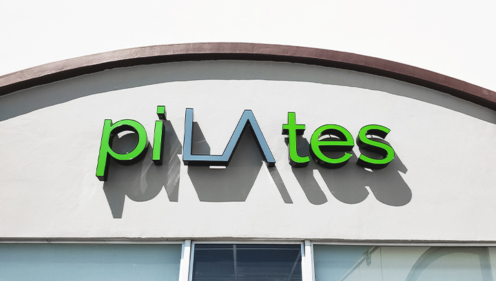 Pilates trim cap channel letters in green and grey colors made of aluminum and acrylic for business outdoor visibility