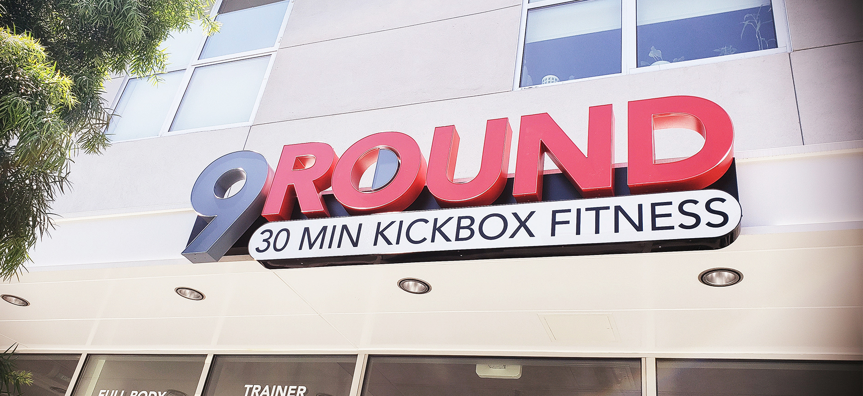 9 Round channel letters in red color displaying the company name made of aluminum and acrylic for gym outdoor branding