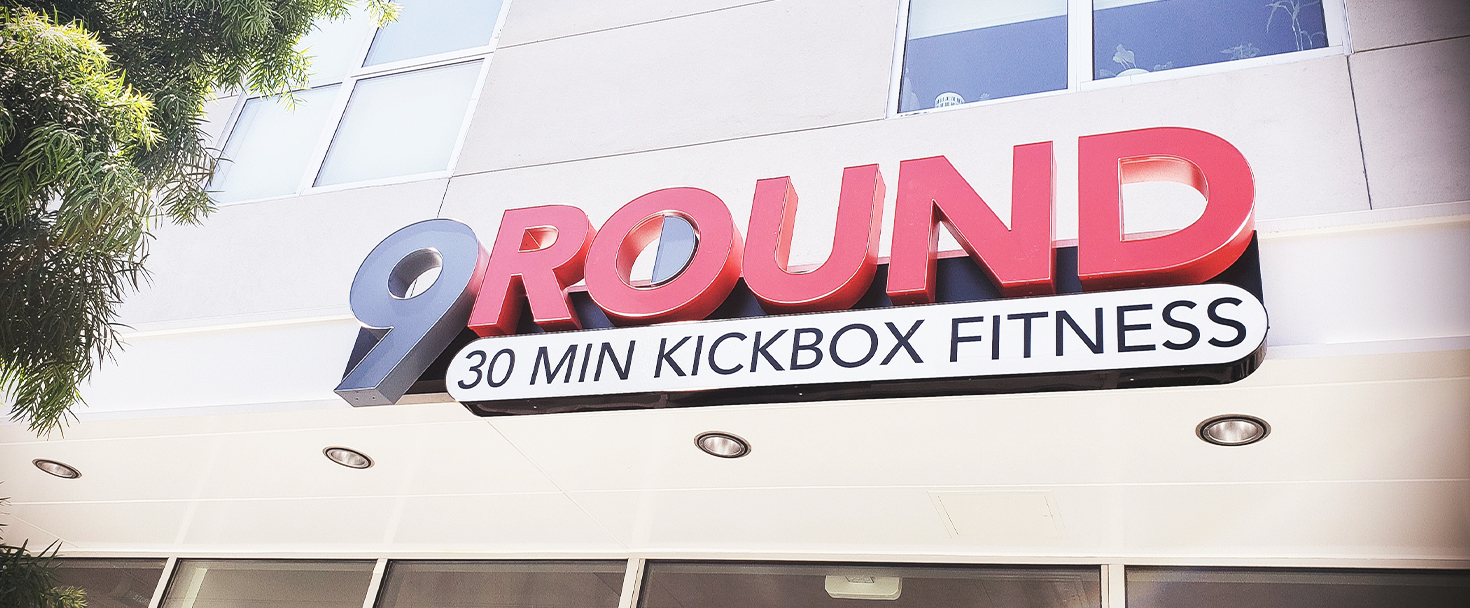 9 Round channel letter sign in red color displaying the company name made of aluminum and acrylic for gym outdoor branding