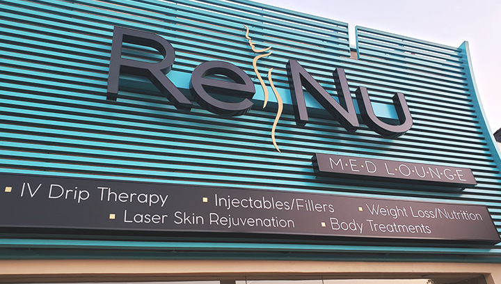 Renu channel letter sign fixed with raceway mounting in black color made of aluminum and acrylic for storefront branding