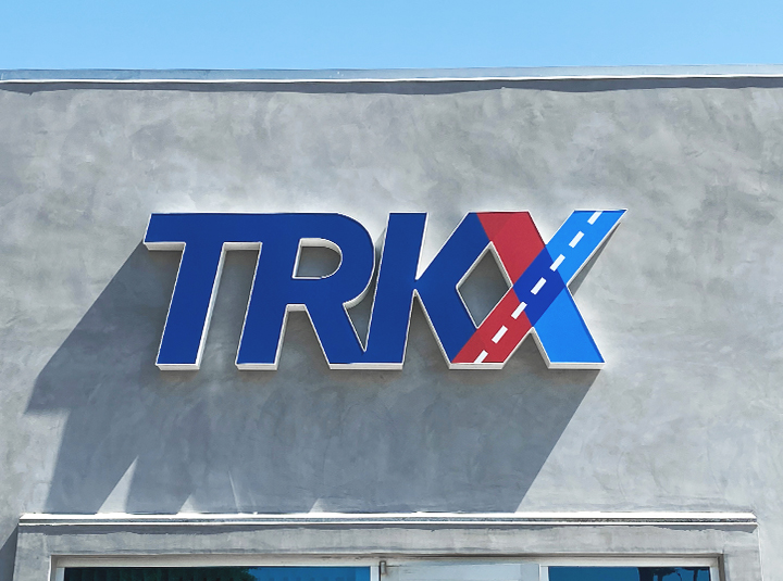 TRKX channel letter sign in a big size displaying the company name made of aluminum and acrylic for brand outdoor visibility