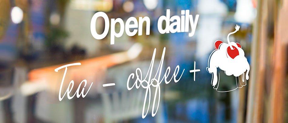 Open daily vinyl lettering window graphics