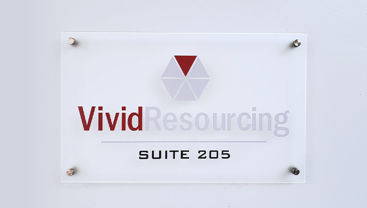 Vivid Resourcing plastic interior sign displaying the company name and logo made of acrylic for branding indoors