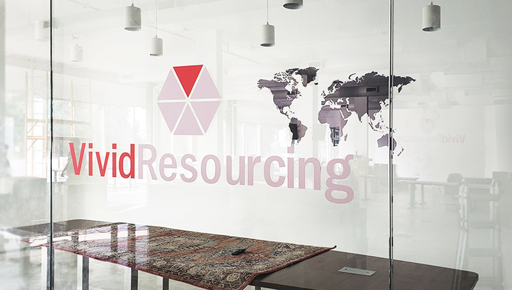 Vivid Resourcing company interior branding signs made of opaque vinyl displayed on the office windows
