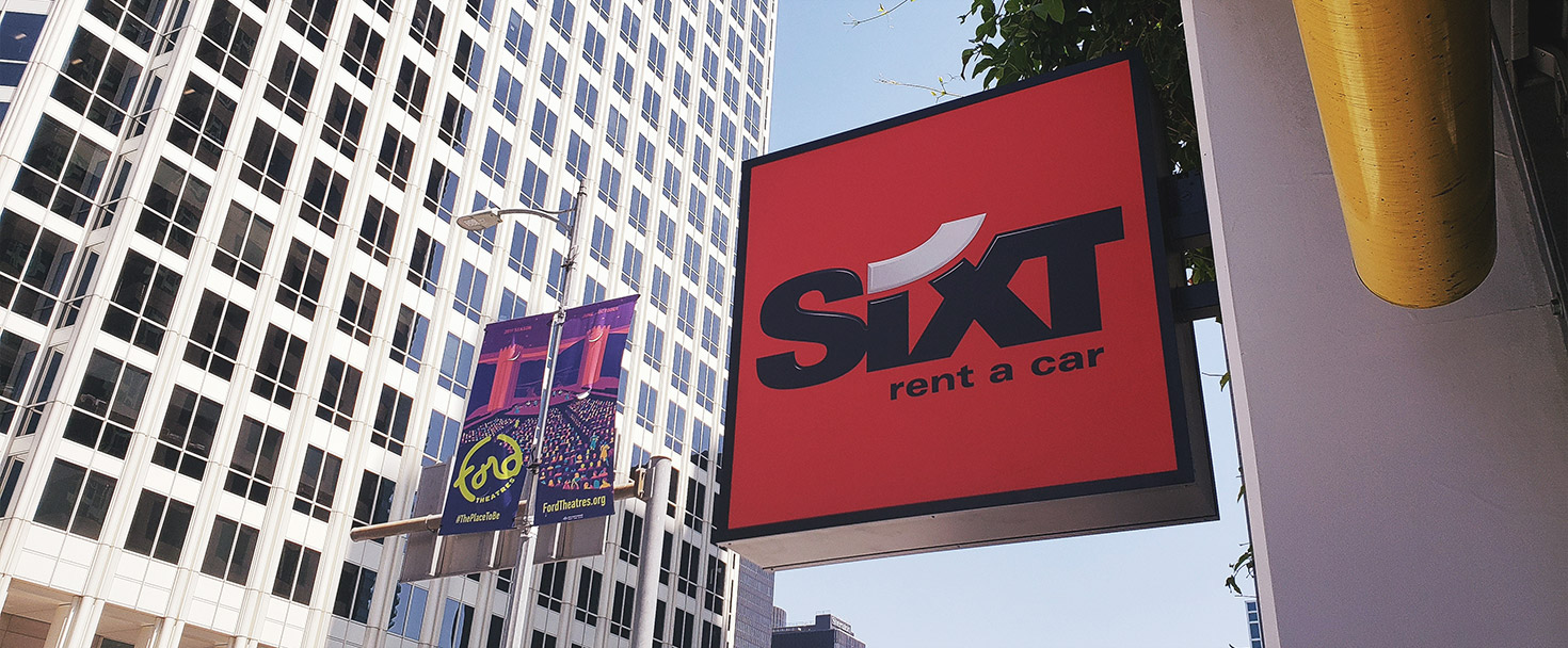 Sixt light box sign in a square shape and wall-blade style made of aluminum and acrylic